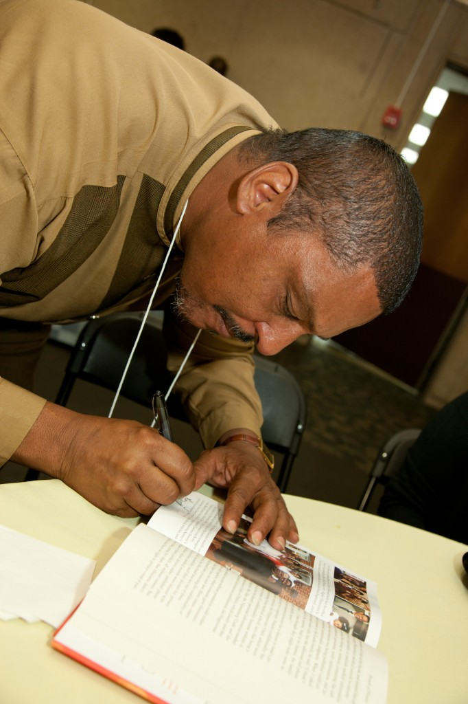 Ron Lacks signing a book