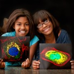 Great-granddaughters of Henrietta Lacks with pictures of HeLa cells