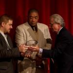 Dr. Robert Blum of the Urban Health Institute presenting their award