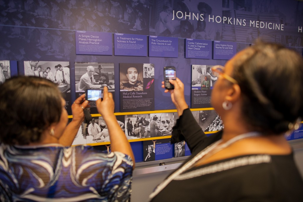 Lacks family viewing Henrietta Lacks tile in Johns Hopkins Hospital