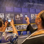 Lacks family viewing Henrietta Lacks tile in Johns Hopkins Hospital